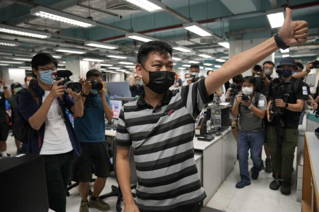 4 journalists at shut Hong Kong paper charged with collusion