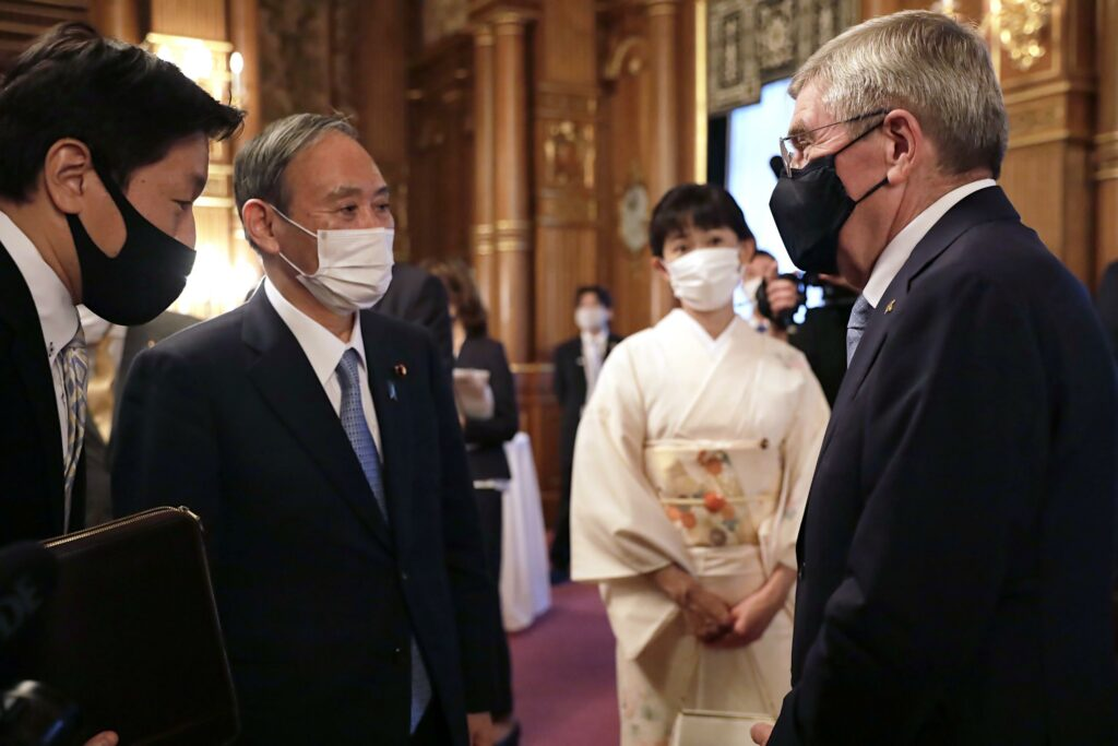 Japanese PM Suga says world should see safe Olympics staged